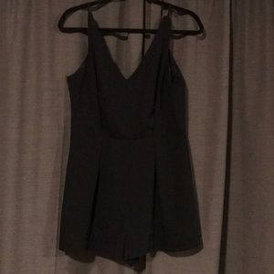 Black Topshop romper with lace back detail. Size 6